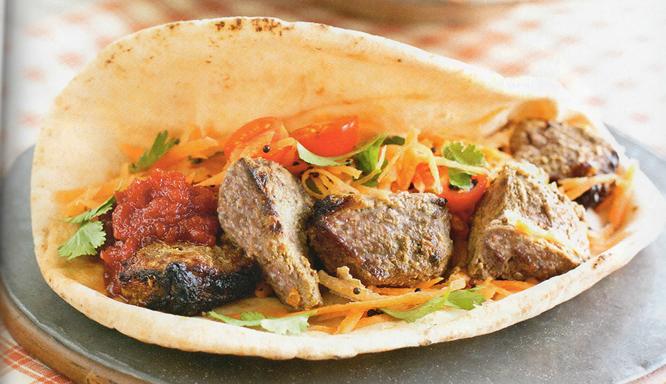 Lamb tikka with spiced carrot salad in flatbread